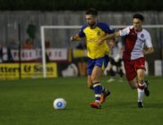 David Noble in action against Poole Town