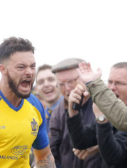 Louie Theophanous celebrtsates after firing the Saints back into the game