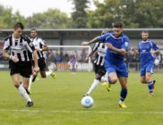 Louie Theophanous drives toward the Magpies penalty area