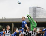 magpies-keeper-carl-pentney-clear-the-danger-as-josh-hill-looks-to-flick-the-ball