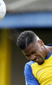 Shaun Lucien heads the ball
