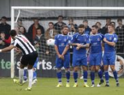 The Saints wall holds firm from Christian Smith's freekick