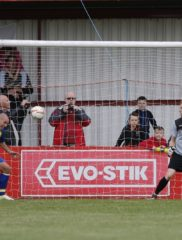 Ben Herd clears of the line from Chris Moore to keep the Saints in the FA Cup