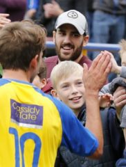 High Five: Sam Merson get the support of young Saints Supporters