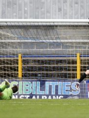 James Russell looks on as tips the ball onto the cross bar