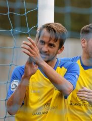 Sam Merson thanks the travelling Saints fans for their support after scoring against Bishop's Stortford
