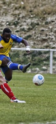 Junior Morias fires the ball at the Whitehawk goal to force a fine save from Ross Flitney