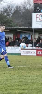 Jamie Cureton lift the ball over the advancing Jamie Butler but is unable to keep the ball under control