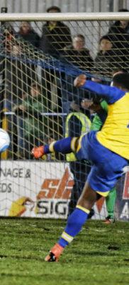 Shaun Lucien blast the ball towards goal