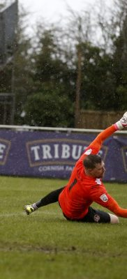 Charlie Walker looks on as his shot goes past Martin Rice into the back of the net