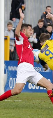 Charlie Walker powers the ball towards goal only to see it hit the arm of the Ebbsfleet centrehalf