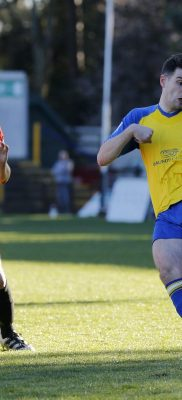 Graeme Montgomery drlls the ball across the Dartford penalty area