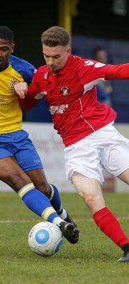 Shaun Lucien battles for control