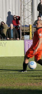 Shaun Lucien blasts the ball towards goal