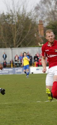 Shaun Lucien drills the ball across the front of the Ebbsfleet goal