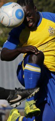 Solomon Sambou puts his head on the ball
