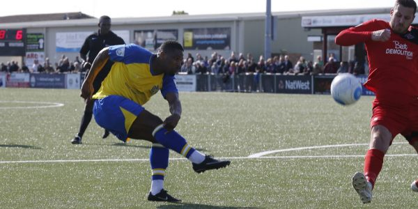 Shaun Lucien blasts the ball towards goal