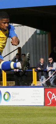 Shaun Lucien has a shot at goal