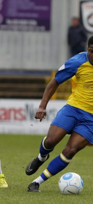Shaun Lucien slips past Ashley Kington