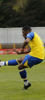 Shaun Lucien slots home the second goal of the game