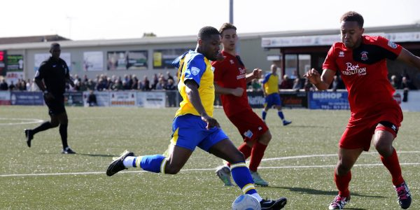 Shaun Lucien tries to find a way through the Eastbourne defences