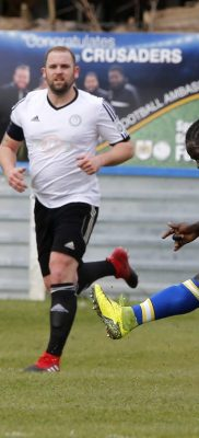 Solomon Sambou clears underpressure from Hungerford