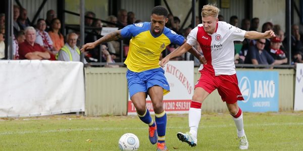 Kieran Monlouis in action against Poole Town