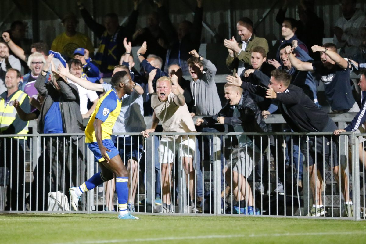 Rhys Murrell-Williamson celebrates with the travelling Saints fans after putting the Saint two up