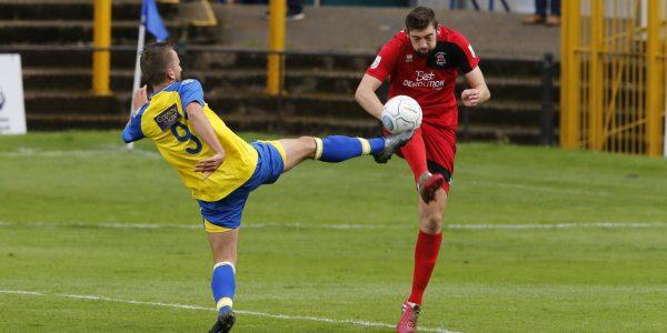 Sam Merson tries to stretch the Eastbourne defense