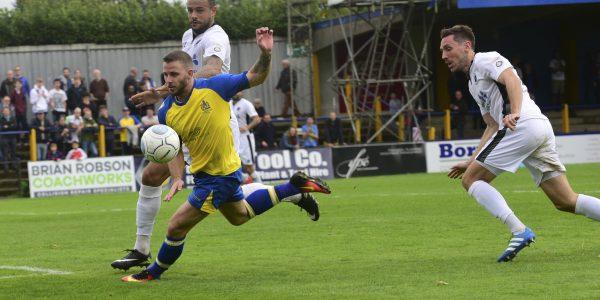 Charlie Walker battles for the ball