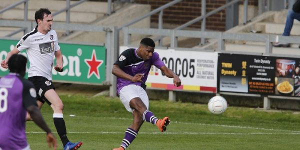 Shaun Lucien drills the ball towards goal
