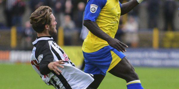 Solomon Sambou rides a tackle