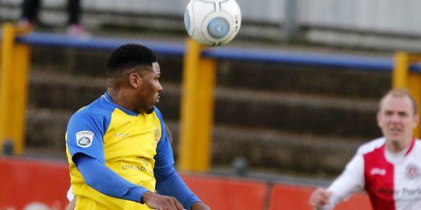 Shaun Lucien heads towards goal