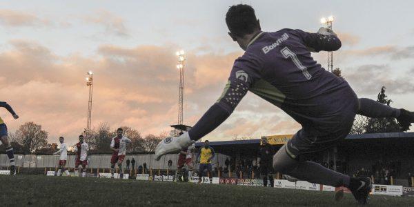 David Noble calmly passes the penalty kick into the net