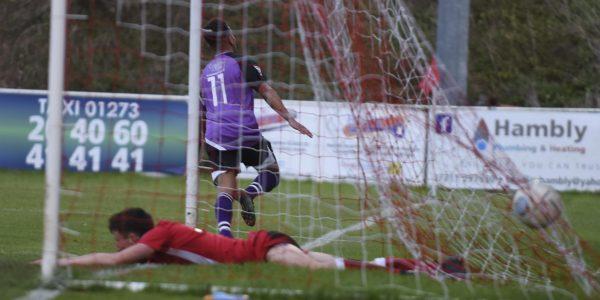 Banton celebrates scoring the opening goal of the game