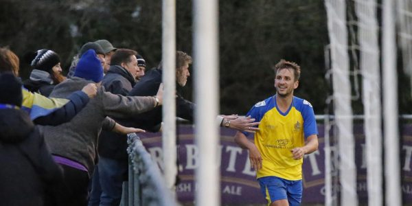 Sam Merson celebrates with the travelling Saints fans