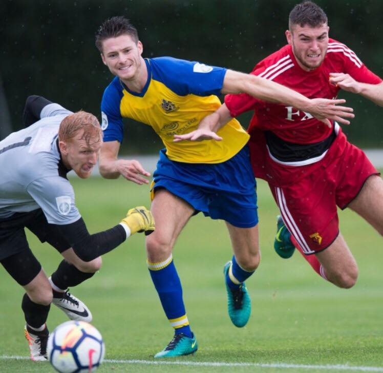 Harvey Bradbury in pre-season action as he attempts to get past Tom Gardiner and James Russell