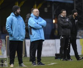 Ian and Lee Allinson watch the proceedings on the pitch as the Saints took on Harrogate Town at Clarence Park