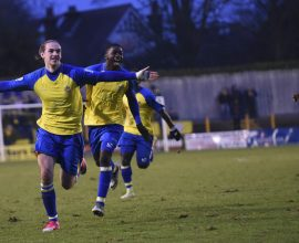 Tom Bender celebrates getting the opening goal of the match