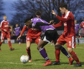 Rhys Murrell-Williamson gets between two Hemel defenders