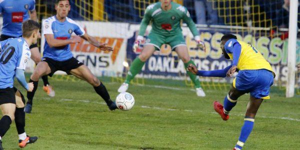 Rhys Murrell-Williamson fires the ball towards goal