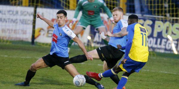 Rhys Murrell-Williamson tries to guide the ball through a crowded Harrogate defense