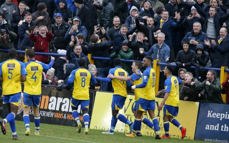 Percy Kiangebeni celebrates infront of the Saints fans after score the Saints third goal of the afternoon