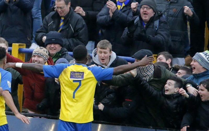 Rhys Murrell-Williamson celebrates with the Saints fans