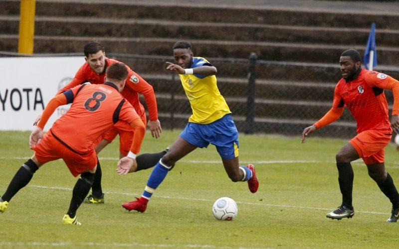 Rhys Murrell-Williamson dancing round the Dartford defense