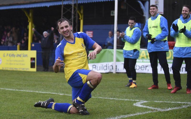 Sam Merson celebrates as subs applaud his goal