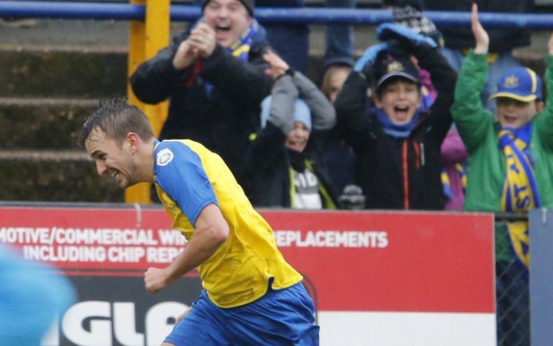 Sam Merson celebrates putting the Saints into a two goal lead