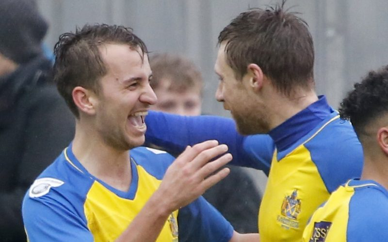 Sam Merson celebrates with captain David Noble after putting the Saints into a two goal lead