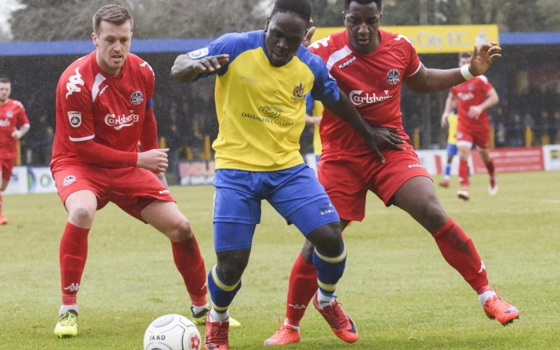 Solomon Sambou under pressure from Truro defenders