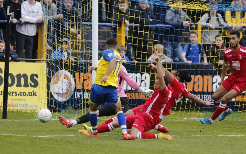 Zane Banton looks on as his shot is saved